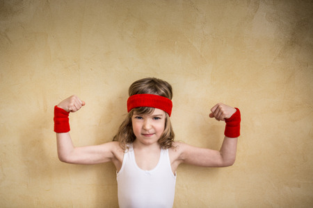 41403074 - funny strong child. girl power and feminism concept